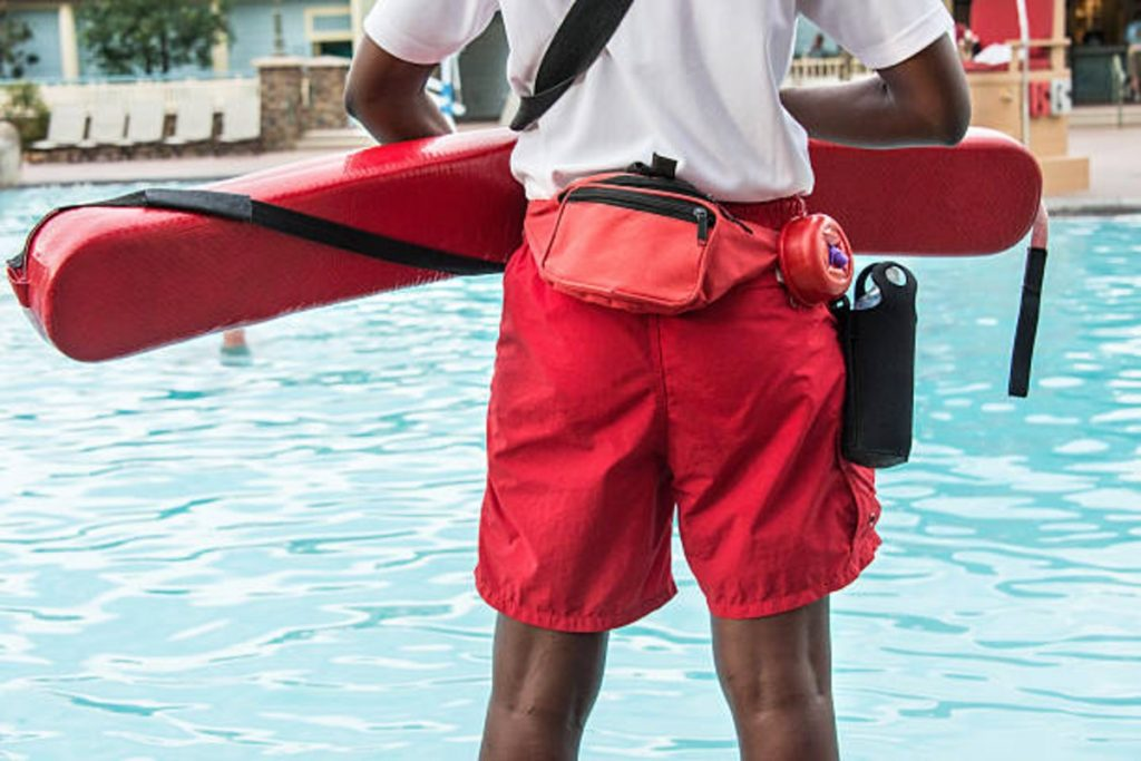 pool lifeguard monitoring the swimming area
