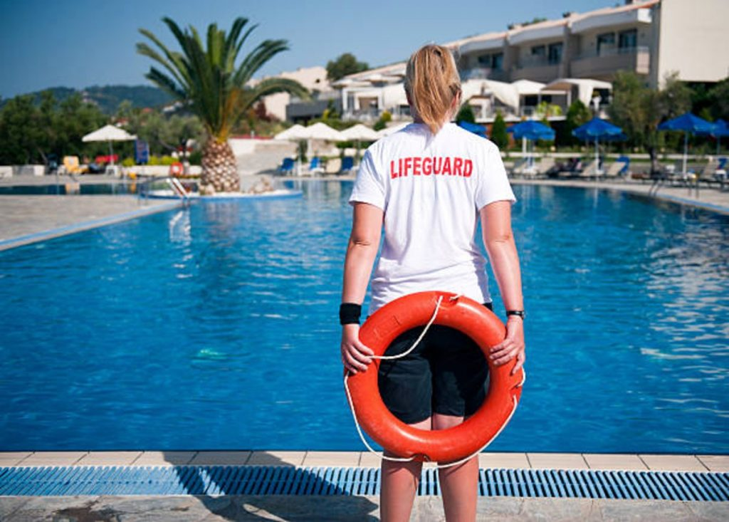 pool lifeguard with a swimming buoy